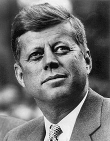 220px-John_F._Kennedy,_White_House_photo_portrait,_looking_up